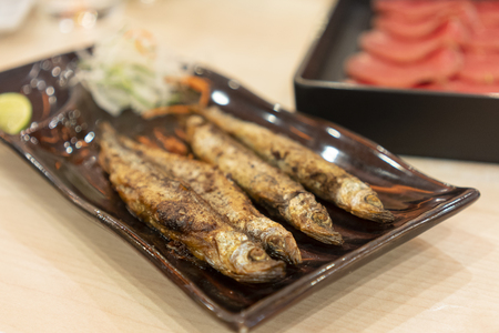 shishamo grilled placed in a plate.