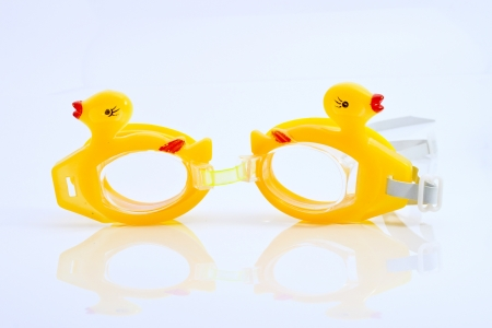 Yellow duck swimming goggles isolated on the white background photo