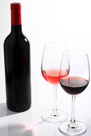 red wine on a white background photo