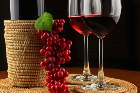 Red wine on a rattan tray photo