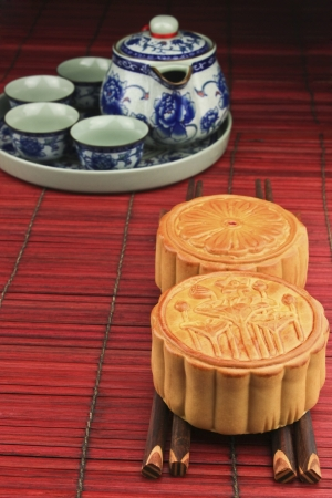 delicious moon cakes  on a wooden chopsticks  photo