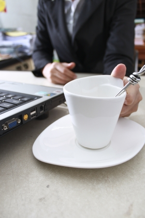 she placed the coffee cup near the computer Stock Photo - 15743634