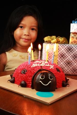 light a candle lit on the ladybug cake Stock Photo - 16013817