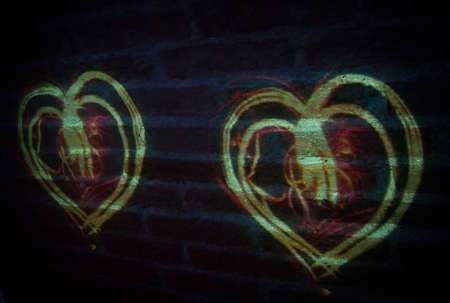 projected: Hearts projected on brick wall