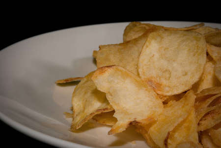 thy: chips on plate, with black background