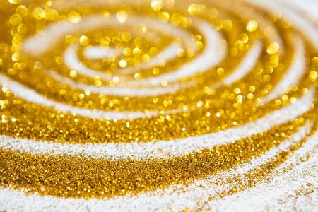 Golden glitter lights background.Christmas background. Golden Holiday abstract Glitter background .Decorative Christmas and New Year party background. Festive backdrop for your projects.