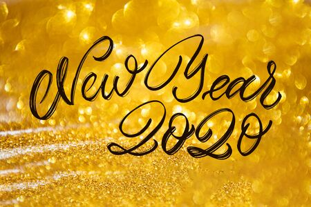 Happy New Year Calligraphy text with colorful hand drawn snowflakes Over Glitter background .Decorative Christmas and New Year party background. Happy New Year 2020 Celebration text.
