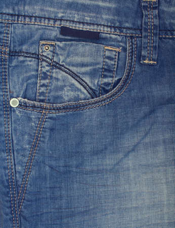 Denim stitching thread close up. The seams on the fabric. photo
