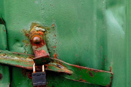 rusty green metal texture of cargo container with padlock