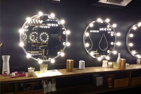 Novosibirsk.Russia-06.05.2019. Atmospheric black interior in the beauty salon. Mirrors with light bulbs. Place for make up.