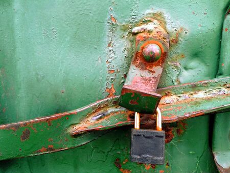rusty green metal texture of cargo container with lock and crossbar for your design. Vintage style.