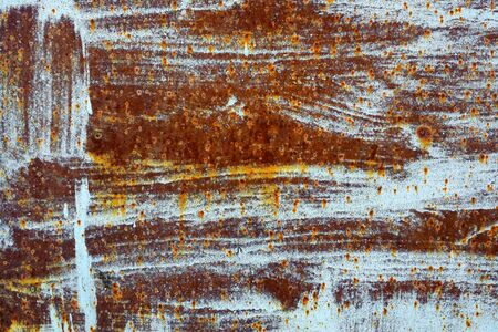grunge rusty metal texture with remnants of blue paint and rusty red points