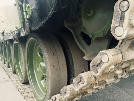 Tracked chassis of military machine running gear on road. Banque d'images