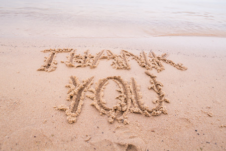 Inscriptions on the sand: Thank you