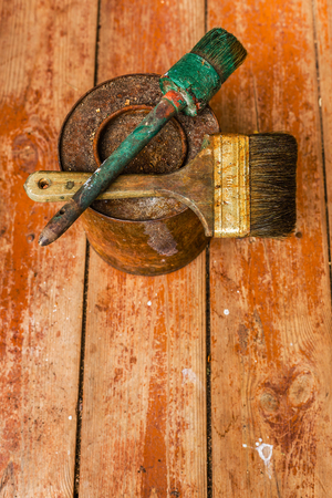 old tools: Spoiled old tools on a wooden floor.