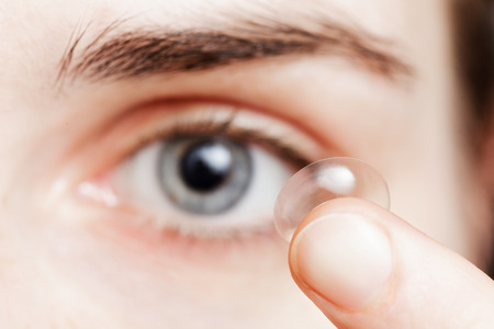 contact lens: Girl changes the lenses to improve vision Stock Photo