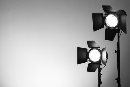 spotlight white background: Empty photo studio with lighting equipment