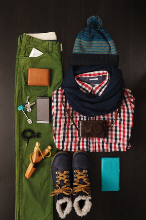 Winter hipster things neatly arranged on a wooden surface