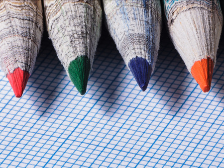 sharpened: Colored pencils with sharpened pencil on a background of blue paper Stock Photo