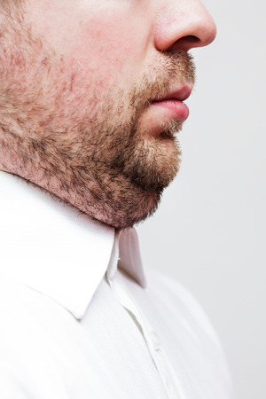 double chin: young man with a double chin - the result of poor lifestyle