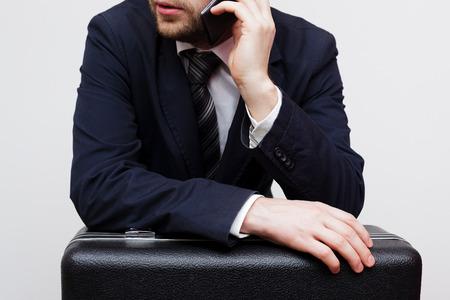 businessman waiting call: Businessman negotiates major deal