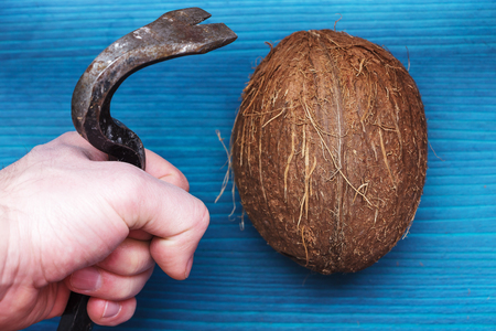 crowbar: simple way to split a coconut with a crowbar