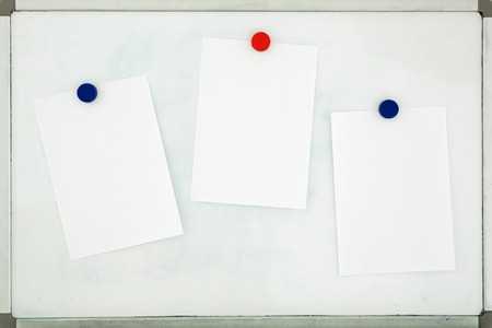 White sheet of paper attached to the old dirty magnetic board