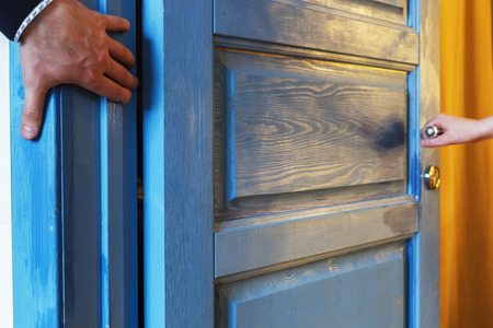 pinched: Man inadvertently pinched his hand in the door
