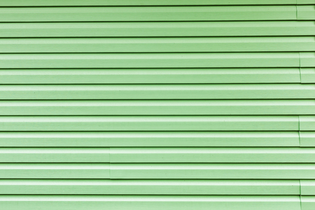 cladding: decorative panels on the building. cladding with siding