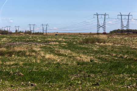electrical tower: Electrical tower on a background of field with green grass