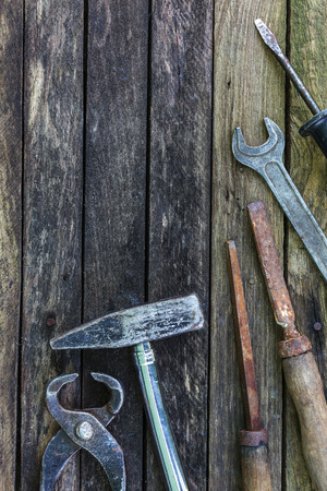 furniture hardware: Old carpentry tools on a wooden background. Preparing for carpentry work