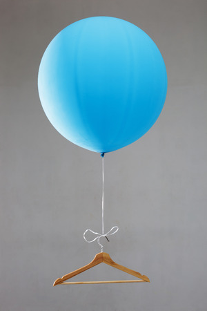 inflating: Balloon with a hanger. Offer of sale. Weight loss diet Stock Photo