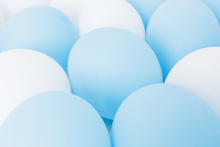 multiple birth: Inflated balloons white and blue. preparation for celebrations, weddings. The background for greeting cards, invitations