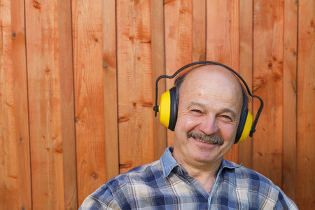 protective: elderly man in a protective building headphones
