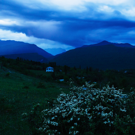 storm coming: Charming and frightening view of the village in the mountains. In the rural settlement storm coming.