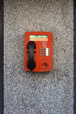 payphone: red payphone on a city street