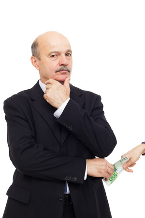 receives: Senior official receives a bribe in secret