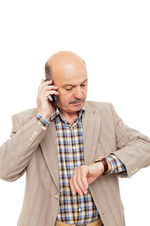 businessman waiting call: Businessman checks the time, person trying to call tech support
