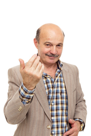 elderly man beckons someone with finger