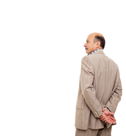 Bald mature man in suit from the backside