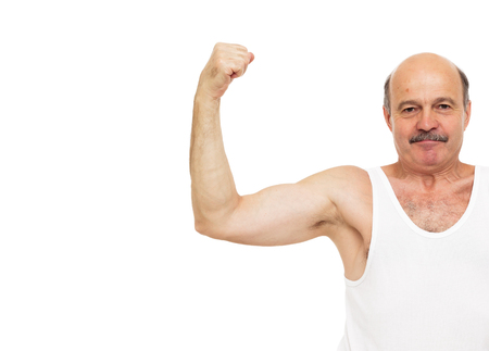 keep fit: Elderly man shows muscles. keep fit by exercise