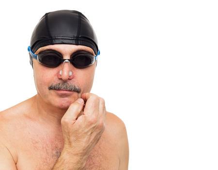 plugging: Elderly man is preparing in swimming cap and goggles for a competition
