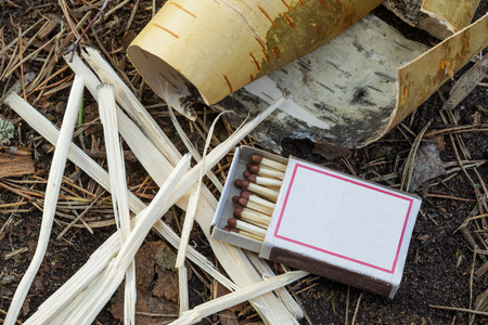 Matches in a box, and bark torch to ignite fire