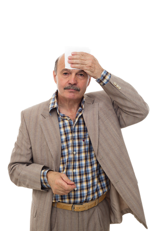 jitter: Elderly and the sick man wipes the sweat from his forehead. To be ill during the heat. Stock Photo