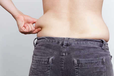 big ass: Weight gain due to improper diet. Fatty side and small pants Stock Photo