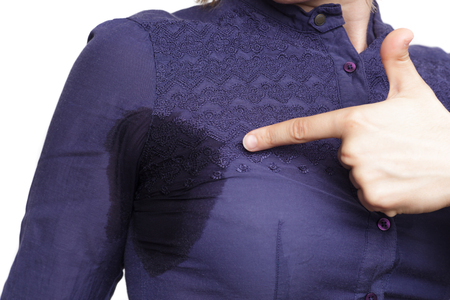 hyperhidrosis: problem with profuse sweating. Wet clothes from the heat Stock Photo