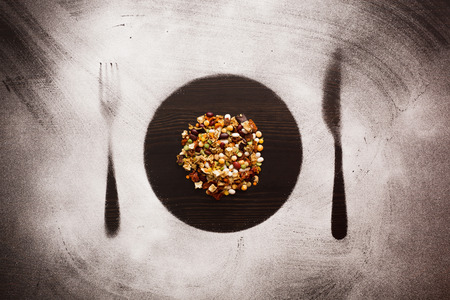 pulses: mixture of pulses and spices in plate, knife and fork silhouettes.