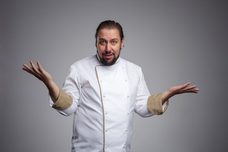 restaurant questions: Cook throws up his hands in bewilderment.