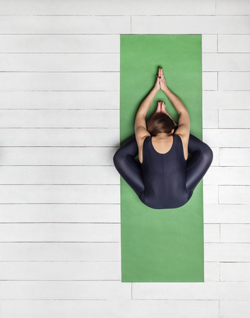 Girl doing butterfly pose or badhakonasana