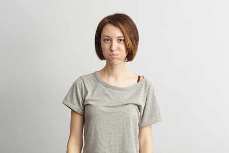 puffed cheeks: Girl puffed out her cheeks. She is offended and dissatisfied. Stock Photo